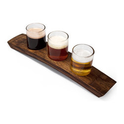Bambeco Portland 3 Beer Flight - Clear - Our Portland 3 Beer Flight - Clear is made from reclaimed wine cooler bottles and wine barrel slats. Nestled in the arched holder, each glass holds up to seven ounces of your beverage of choice, ideal for a beer tasting. Or have some fun and pour wine, be sure to turn the tray to reveal its former life as a wine barrelExpand their useful lives even more and press these glasses into service as dip holders, nut or candy dishes, or even small dessert cups. The Portland Beer Flight Taster is available as a set of three or five glasses on a tray and comes in your choice of green or clear glass. Each tray is unique, and tray size, color and appearance will vary.Dimensions: 15W x 3D x 4.25H.