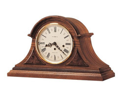Howard Miller - Howard Miller - Worthington Mantel Clock - Time wanders from hand to hand in this exceptionally crafted beaded dentil mantel clock defined by captivating Yorkshire oak finish and one-of-a- kind triangular Carpathian elm burl overlays, a dynamic piece to enhance your living or dining room mantel, study or nightstand. * Rare triangular Carpathian elm burl overlays. . Beaded dentil molding above the full plinth base.. Cream colored Roman numeral dial with convex glass crystal and solid brass, hinged bezel. . Durable bronze bushings.. Finished in Oak Yorkshire on select hardwoods and veneers.. Key wound, Westminster chime movement with chime silence option and durable bronze bushings.. 100-3/4in (27 cm) H x 8iin (46 cm) W x 6-1/2in (17 cm) D