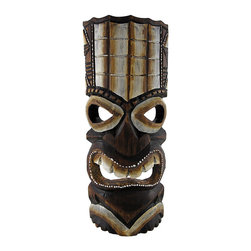 Dark Brown Tiki Mask with Tan and White Headdress 11 In. - This dark brown tiki mask is hand crafted from wood and features a tan and white headdress and accents. It measures approximately 11 inches tall, 4 1/2 inches wide, and has a hanger on the back. This mask looks great in your home or on your porch or patio, and it is a must-have for any tiki bar. It also makes a great gift for friends and family. NOTE: Since these masks are hand carved and hand painted, there may be slight color or facial differences from the pictures.