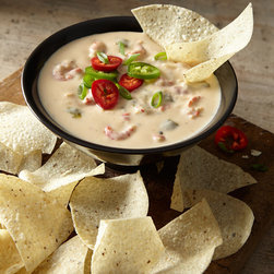 Horchow - Crawfish Queso Cheese Dip - N/A - Crawfish Queso Cheese DipDetailsA combination of diced onions bell peppers jalapenos and spices in creamy cheese sauce topped with Louisiana crawfish tails.Ships fully cooked and frozen; keep frozen until ready to heat. Thaw in refrigerator 4-6 hours or overnight. Place boil-in bag in saucepan of water bring to a boil and boil for 10-15 minutes.Serve with chips or thinly sliced toasted French bread (not included).64 ounces. Serves 16; approximately 4 ounces per serving.Made in the USA.Perishable items are shipped to you directly from our vendors. Therefore if you need to cancel an order we must receive the cancellation at least four days prior to your requested delivery date. We added all garnishes as inspiration for your own presentations.Allergen Information: Contains dairy and shellfish.