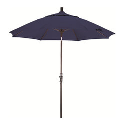 None - Fiberglass 9-foot Sapphire Blue Olefin Crank and Tilt Umbrella - Enjoy the view of your outdoor area in the shade with this sapphire-blue umbrella. This stylish patio umbrella is nine feet tall and round. It is composed of a fade-resistant fabric that is durable and built to provide you with shade for a long time.
