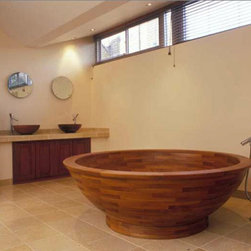 Helio Teak Wood Bathtub - Each custom crafted Helio bath is an extraordinary piece of wood engineering. Perfect for a long soak that warms the body and relaxes tired muscles and nerves. Teak is warm to the touch and an excellent insulator, thus helping to keep the water hot.