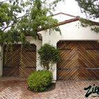 Spanish Style Garage Doors - Ziegler Spanish garage doors are simply designed to compliment the cleanliness of old Spanish and California mission architecture. Whether the backdrop is a Spanish Villa or a Mexican Hacienda you will find that the beauty of the wood makes the biggest impression.