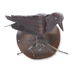 Raven Sculpture - This Raven sculpture is handmade in Pennsylvania by Ben Gatski. The metal we used is from weathered steel. We hand draw the pattern on the metal with soapstone and cut it with a hand held plasma cutter. We then hand hammer and weld it into shape.