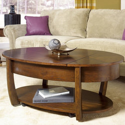 "Hammary - Concierge Oval Lift-Top Cocktail Table in Medium Brown Finish - ""With its stunning new """"Concierge"""" collection, Hammary has thought of everything. No detail is too small, no convenience overlooked. Nothing spared to create some of the finest furniture on the market."