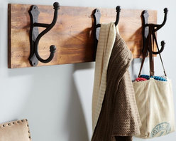 Overscaled Row of Hooks - A set of rustic hooks on reclaimed wood would be a beautiful way to store towels in a bathroom. The oversize dimensions of this rack make it a very cool piece to include.