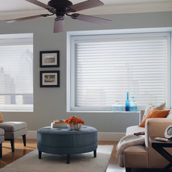 Control light & maintain your view - Shangri-La sheer horizontals filter light & add privacy to this urban space.  The neutral furnishings are accented with orange flowers and blue glass. Compare to Silhouette shades for the same look with a lower price tag. Photo by Comfortex
