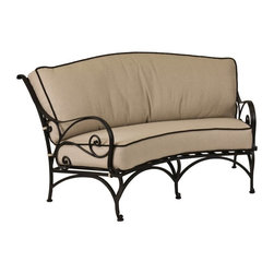 O.W. Lee - O.W. Lee Ashbury Aluminum Cuddle Chair - 1585-2S-SP11-GL02A - Shop for Chairs and Sofas from Hayneedle.com! Cuddle up a little closer in the O.W. Lee Ashbury Cuddle Chair. This innovative sofa gives you and a fellow lounger tons of room to get comfy cozy together encouraged by the clinging vine-like scrolling on the back arms and legs. And when you are entertaining friends on a less intimate scale the wide curved back of this seat helps focus a conversation area toward a center point that keeps everyone together making for more inclusive memorable conversations. Its wide seat sturdy arms and thick cushions invite you to sink right in while enjoying time with your company. And the beautiful scrollwork adds to your outdoor decor a classic appeal that also possesses a fashion-forward individuality. This sensually curving metalwork is hand forged and hammered bringing a uniquely masterful craftsmanship to these chairs.Materials and construction: Only the highest quality materials are used in the production of O.W. Lee Company's furniture. Carbon steel galvanized steel and 6061 alloy aluminum is meticulously chosen for superior strength as well as rust and corrosion resistance. All materials are individually measured and precision cut to ensure a smooth and accurate fit. Steel and aluminum pieces are bent into perfect shapes then hand-forged with a hammer and anvil a process unchanged since blacksmiths in the middle ages. For the optimum strength of each piece a full-circumference weld is applied wherever metal components intersect. This type of weld works to eliminate the possibility of moisture making its way into tube interiors or in a crevasse. The full-circumference weld guards against rust and corrosion. Finally all welds are ground and sanded to create a seamless transition from one component to another. Each frame is blasted with tiny steel particles to remove dirt and oil from the manufacturing process which is then followed by a 5-step wash and chemi