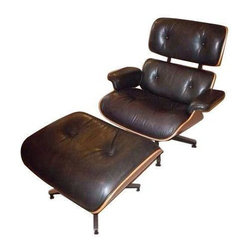 Used Eames Herman Miller Lounge Chair & Ottoman - A Mid-century Modern classic: an authentic Herman Miller Eames lounge chair and ottoman. This premium black leather piece is finished in rich cherry wood and is absolutely gorgeous. It was previously used as a room accent, so it's in as close to mint condition as these loungers come.