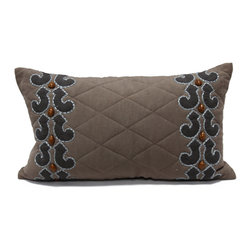 Malta Pillow - A rich rectangular throw pillow that provides plump coziness, contrasting texture, and intriguing beading to your decor, the Malta decorative cushion is made with a base of dark grey linen which has been quilted in a classic diamond pattern. At either shorter side of the feather-stuffed rectangle, appliques of a coarser-weave fabric with a slight sheen alternate with marbled caramel beads. The colors are technically neutrals, but the warmth and saturation of their palette make them quite bold.