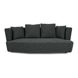 STUDIO COPENHAGEN - Merton Dark Grey 3-Seat Couch - The Merton 3 Seater Couch features a high back and a polygonal curved front, and together with the generous cushions, the Merton couch will cocoon you in total comfort in a soothing, interesting atmosphere.
