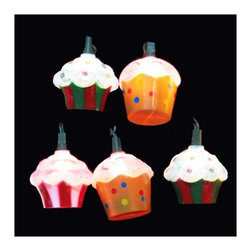 "Lamps Plus - Kids Ten Cupcakes Party String Lights - Add a little fun to your indoor or outdoor spaces with this set of ten string lights featuring little delicious cupcakes. Perfect for entertaining or as an eye-catching accent in bedrooms and more these lights add personality and cheer. Includes four spare bulbs and green wire. Cupcake string lights. 10-light string. For indoor and outdoor use. Includes ten 12v .08A clear incandescent bulbs. Includes 4 spare bulbs and 1 fuse. Includes 30"" of green lead wire. 12"" of spacing between lights.   Cupcake string lights.  10-light string.  For indoor and outdoor use.  Includes ten 12v .08A clear incandescent bulbs.  Includes 4 spare bulbs and 1 fuse.  Includes 30"" of green lead wire.  12"" of spacing between lights."
