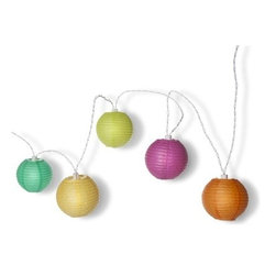 Oh Joy! Colored Lantern String Lights - If you are planning to host your outdoor party at night, creating the right atmosphere is essential. These colorful, festive lights are the perfect addition.