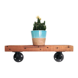 Pierce Industrial Shelf - A few favorite books, a houseplant, a vase or other decor--sometimes you want just a hint of shelving to hold up something truly spectacular. Draw attention to your favorite things with this handsome shelf, handmade from eco-friendly reclaimed wood and piping.