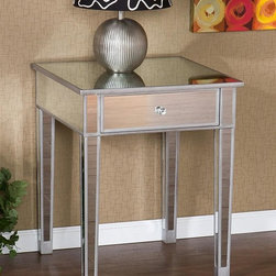 Holly & Martin - Holly & Martin Montrose Mirrored Accent Table - Painted silver wood trim. Mirrored finish. Drawer: 15 in. W x 15 in. D x 5 in. H. Overall: 23.75 in. W x 23.75 in. D x 28.75 in. H (48.57 lbs.)Perfect for any room, this glamorous mirrored end table is a perfect compliment for your home. With its mirrored finish, it adapts to any surroundings without overpowering yet, catches your eye with its unique presence. The practical size and function works as well in the living room as it does bedside. Finishing the table off is a spacious drawer with faux crystal knob.