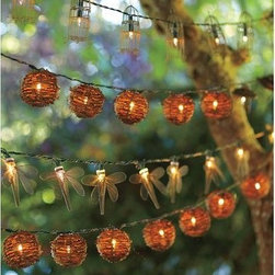 Wire Dragonfly String Lights - Add some light at night with these adorable dragonfly lights. I like how they pair them with classic circle ones, too.