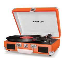 Crosley Radio - Cruiser 3-Speed Portable Turntable - Orange - Belt driven turntable mechanism. Vinyl Wrapped. Plays 7, 10 and 12 inch records. Dynamic Full Range Stereo Speakers. Headphone Jack. Portable Turntable. Manual Return Tone Arm. AC Power Adapter. RCA Audio Out. Portable Audio Read (Simply plug in your portable audio device or MP3 player). 5 lbs.Love the rich, warm sound of vinyl, but wish it was a more moveable music format? Put down the iPod and mobilize your music with the Crosley Cruiser three-speed portable turntable. Constructed of wood and bound in a leatherette material, the briefcase-styled record player is lightweight and easily transported from place to place. It features built-in stereo speakers so you can listen to your music without having to connect it to a speaker system. Cruise over to a friend's house and experience vinyl's superior sound together.