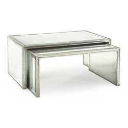 Kathy Kuo Home - Jasmine Hollywood Regency Silver Leaf Mirror Nesting Coffee Table - Set of 2 - Of all the space saving pieces of furniture, nesting tables take the cake for sheer utility and style.  When clad in a Verre Eglomise mirrored finish, these workhorses become showpieces.  This pair are particularly noteworthy for the antique silver leaf finish on the molding.