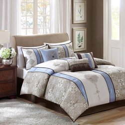 Madison Park - Madison Park Donovan 7 Piece Comforter Set - Donovan is an elegant update to your bedroom. This blue comforter features a modern color blocked look with embroidered taupe details. The bold blue stripes draw your eye into this beautiful comforter. Three decorative pillows further accentuate the colors and embroidered details in this collection. Also includes two king shams which pull the whole look together. The comforter is made from 100% polyester and is machine washable for easy care. Comforter & Sham: 100% polyester jacquard pieced with solid polyoni with embroidery, 100% polyester brushed fabric reverse Filling: 270g/m2 polyester Bedskirt: 100% polyoni drop, polyester platform Pillow: 100% polyester shell, polyester filling