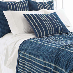 "Pine Cone Hill - PCH Resist Stripe Indigo Coverlet - Inspired by an artistic block print, the Resist Stripe coverlet lends a touch of global glamour. This contemporary blanket boasts the chic yet casual style in indigo, navy and white. 96""W x 96""H; 100% cotton; Navy reverse with blue and white quilting; Tailored edge; Designed by Pine Cone Hill, an Annie Selke company; Machine wash"