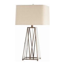 Arteriors Home - Arteriors Home Edmond Glass/Antique Brass Lamp - Arteriors Home 46825-769 - Arteriors Home 46825-769 - The Edmund table lamp borrows influence from mid-century modern style with geometric angles in its sleek frame. One side of its unique base opens with a hidden clasp, allowing you to place with decorative objects or treasures inside. French wired, the lamp cord exits the antique brass neck above the lamp body, as opposed to running down the lamp internally and exiting at the base.