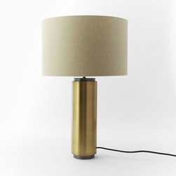 Pillar Table Lamp, Antique Brass - This sleek brass lamp would fit in with the midcentury modern vibe without being too much of a throwback.