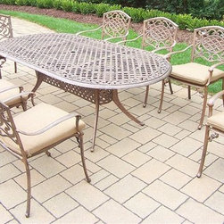Oakland Living - 9-Pc Patio Oval Dining Set - Includes one oval dining table, eight stackable chairs with cushions and metal hardware. Fade, chip and crack resistant. Traditional lattice pattern and scroll work. Handcasted. Umbrella hole table top. Hardened powder coat. Warranty: One year limited. Made from rust free cast aluminum. Antique bronze finish. Minimal assembly required. Chair: 23 in. W x 22 in. D x 35.5 in. H (25 lbs.). Table: 84 in. L x 42 in. W x 29 in. H (99 lbs.). Overall weight: 290 lbs.This dining set is the prefect piece for any outdoor dinner setting. Just the right size for any backyard or patio. We recommend that the products be covered to protect them when not in use. To preserve the beauty and finish of the metal products, we recommend applying an epoxy clear coat once a year. However, because of the nature of iron it will eventually rust when exposed to the elements. The Oakland Mississippi Collection combines southern style and modern designs giving you a rich addition to any outdoor setting.