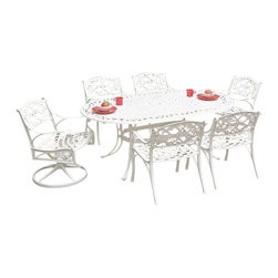 """Home Styles - Home Styles Biscayne 7-Piece 72"""" Oval Dining Table Set - Home Styles - Patio Dining Sets - 55523358 - Biscayne 7-Piece Dining Set includes the Oval Table Four Arm Chairs and Two Swivel Arm Chairs. Home Styles cast aluminum outdoor dining collection gives you the beauty of ornately designed pieces without the high cost.  Constructed of cast aluminum in a UV resistant powder coated hand applied White finish. The Oval Dining Table features a top that is designed specifically to prevent damage caused from pooling by allowing water to pass through freely.  Adjustable nylon glides prevent damage to surfaces caused by movement and provide stability on uneven surfaces. Size:  42w 72d 30h. Home Styles Arm Chair is constructed of cast aluminum with a White Finish. Features include powder coat finish sealed with a clear coat to protect finish and nylon glides on all legs. Chairs are packed two per carton. Item Size: 22.83w 21.65d 32.68h (Seat height 15.5H) Home Styles Swivel Arm Chair is constructed of cast aluminum with a White Finish. Features include powder coat finish sealed with a clear coat to protect finish and nylon glides on all legs. Item Size: 24.4w 22d 33.46h (Seat height 16). Stainless steel hardware."""
