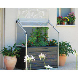 "Poly-Tex, Inc. - Plant Inn Compact Raised Garden Bed Greenhouse - Plant Inn compact raised garden greenhouse makes gardening accessible for everyone and is perfect for growing on your balcony or deck. The Plant Inn Compact is 46"" x 24"" and the raised beds are 28"" off the ground. The peak is 58 1/2"" high and has an adjustable lid for easy access and temperature control. The lid can lock open for either full access to do your planting and harvesting or partially for ventilation. The unbreakable polycarbonate panels help protect your plants from pests and cold. Includes a 6 1/2"" deep planting area, internal water drainage and plant hangers for trellising. The plant Inn compact has a built in storage space under the tray for all of your gardening tools and accessories."