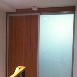 Bamboo /Frosted Glass Sliding Door - Custom sliding doors made to order by Closet Solutions. Serving  Greater Boston, Massachusetts. 617.628.2410
