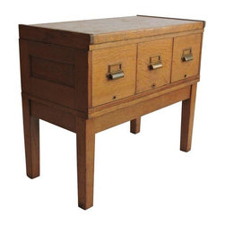 "Pre-owned Tiger Oak Filing Cabinet Library Table Circa 1919 - Tiger Oak library table, filing cabinet /console perfect in any setting.For a small apartment dining area, it is the perfect buffet. It serves equally well in the office or as a media stand.    The piece was manufactured in 1919 by GOP . HAM. A globe shaped emblem is under the table top with the words Trade Mark GOP . HAM Inspector No. 9 June 3,1919.     The beautiful quartersawn grain is as bright today as it was when the console was manufactured. It is a mix of veneers, plywood and hardwood. The deep drawers are the perfect size for narrow files or books or kitchen accessories. The table has its original brass pulls and steel dividers, as well. The drawers are missing the bars that once held the card files.    The table top lifts off. The base is also a separate unit.     Excellent condition in view of its age. Any wear is minimal and commensurate with age and use. The back of the cabinet was painted at one point. See photos! Wear is commensurate with age and use.    Inside measurements: 16"" Deep x 9.5"" wide Height 8"" at the front of the drawer with a 5"" side.   A file would need to measure 9.5"" x 7.5"" at the most."