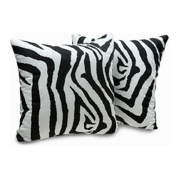 None - Zebra Print Decorative Throw Pillows (Set of 2) - These zebra print decorative throw pillows are made of 100-percent cotton and offer a stylish black and white zebra pattern. They are sewn closed and each member of the set measures 18 inches high by 18 inches wide.