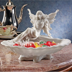 Design Toscano - Design Toscano 6.5 in. The Fairys Decorative Bowl - WU10423 - Shop for Decorative Bowls and Vases from Hayneedle.com! The enchanting Design Toscano 6.5 in. The Fairys Decorative Bowl entices everyone to come closer. This Victorian fairy beauty is cast in bonded marble resin with a deep shell dish that makes it an elegant addition to your powder room dressing table or decorative sideboard. A gorgeously detailed piece!About Design ToscanoDesign Toscano is the country's premier source for statues and other historical and antique replicas which are available through the company's catalog and website. Design Toscano's founders Michael and Marilyn Stopka created Design Toscano in 1990. While on a trip to Paris the Stopkas first saw the marvelous carvings of gargoyles and water spouts at the Notre Dame Cathedral. Inspired by the beauty and mystery of these pieces they decided to introduce the world of medieval gargoyles to America in 1993. On a later trip to Albi France the Stopkas had the pleasure of being exposed to the world of Jacquard tapestries that they added quickly to the growing catalog. Since then the company's product line has grown to include Egyptian Medieval and other period pieces that are now among the current favorites of Design Toscano customers along with an extensive collection of garden fountains statuary authentic canvas replicas of oil painting masterpieces and other antique art reproductions. At Design Toscano attention to detail is important. Travel directly to the source for all historical replicas ensures brilliant design.