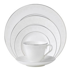 Wedgwood St. Moritz 5 Piece Place Setting - Ethereal white-on white mirages adorn the Wedgwood St. Moritz 5 Piece Place Setting, bringing the intricacy of lace, snow, and cameos to your table. The St. Moritz collection is inspired by the breathtaking beauty of Switzerland's snowcapped peaks. Rimmed with lustrous platinum, the refinement and opulence are stratospheric.Set Includes:dinner platesalad platebread & butter plateteacuptea saucerAbout WedgwoodThrough highly skilled craftsmanship and the highest quality standards, Wedgwood manufactures quality ceramics with sophisticated, classical, and contemporary design. With a tradition of innovation, quality, and craftsmanship, Wedgwood designs are widely acknowledged as timeless, elegant, classic, and understated. Their design teams work with external designers for cross-pollination of ideas and experience. Founded in 1759 by Josiah Wedgwood, Wedgwood has been an international company determined to uphold their standards in order to maintain their leadership in the world's markets. Though their roots are over two centuries old, the company strives to stay current through partnerships with fashion designers Jasper Conran and Vera Wang with whom they've developed contemporary and stylish ranges that appeal to the younger consumers.