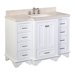 Kitchen Bath Collection - Nantucket 48-in Bath Vanity (Crema Marfil/White) - This bathroom vanity set by Kitchen Bath Collection includes a white cabinet with soft close drawers, double thick Crema Marfil countertop, double undermount ceramic sinks, pop-up drains, and P-traps. Order now and we will include the pictured three-hole faucets and a matching backsplash as a free gift! All vanities come fully assembled by the manufacturer, with countertop & sink pre-installed.