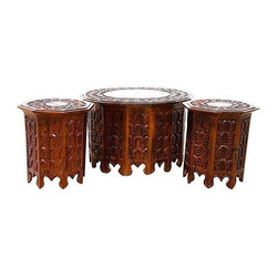 """Pre-owned Indonesian Style Teak Tables - Set of 3 - An ornate set of three handmade Indonesian style teak tables. They have intricately hand carved detailing throughout, but no maker's mark, and are in excellent condition. The coffee table measures 26""""Dia. x 16.5""""H, while the side tables are 15.5""""Dia. x 16""""H."""