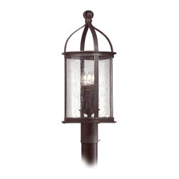 "Troy - Scarsdale Collection 23 1/2"" High Outdoor Post Light - The Scarsdale outdoor collection from Troy Lighting lights your home's exterior with time-honored beauty. This simple refined design is crafted from hand-forged iron and presented in a forged black finish. Heritage seeded glass gracefully displays glowing fixtures within. A classic design for lighting your outdoor spaces. Hand-forged iron construction. Forged black finish. Heritage seeded glass. Takes three 60 watt candelabra bulbs (not included). 23 1/2"" high. 10"" wide.  Hand-forged iron construction.   Forged black finish.   Heritage seeded glass.   Takes three 60 watt candelabra bulbs (not included).   23 1/2"" high.   10"" wide."
