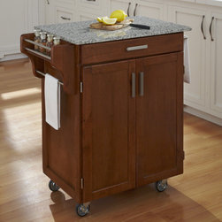 "Home Styles - Kitchen Cart with Granite Top - This kitchen utility carts feature solid wood construction, heavy duty casters, concealed storage, and so much more! Features: -Grey granite top.-Enclosed storage with MDF insert panels on cabinet doors for increased strength.-Utility drawer with metal drawer suspensions.-Brushed chrome pulls.-Adjustable condiment or spice caddy.-Towel bars.-Heavy duty casters, with front casters locking.-Solid wood construction.-Product Type: Kitchen Cart.-Collection: Cuisine Cart.-Counter Finish: Granite.-Hardware Finish: Brushed Steel.-Distressed: Yes.-Powder Coated Finish: No.-Gloss Finish: No.-Base Material: Wood.-Counter Material: Salt and Pepper Granite.-Hardware Material: Brushed Steel.-Solid Wood Construction: Yes.-Number of Items Included: 1.-Water Resistant or Waterproof Cushions: No.-Stain Resistant: No.-Warp Resistant: No.-Exterior Shelves: No.-Drawers Included: Yes -Number of Drawers: 1.-Push Through Drawer: No..-Cabinets Included: Yes -Number of Cabinets : 1.-Double Sided Cabinet: No.-Adjustable Interior Shelves: Yes.-Number of Doors: 2.-Locking Doors: No.-Door Handle Design: Linear pulls..-Towel Rack: Yes -Removable Towel Rack: No..-Pot Rack: No.-Spice Rack: Yes .-Cutting Board: No.-Drop Leaf: No.-Drain Groove: No.-Trash Bin Compartment: No.-Stools Included: No.-Casters: Yes -Locking Casters: Yes.-Removable Casters: No..-Wine Rack: No.-Stemware Rack: No.-Cart Handles: No.-Finished Back: Yes.-Commercial Use: No.-Recycled Content: No.-Eco-Friendly: No.-Product Care: Clean with a damp cloth.Specifications: -ISTA 3A Certified: Yes.Dimensions: -Overall Height - Top to Bottom: 35.5"".-Overall Width - Side to Side: 32.5"".-Overall Depth - Front to Back: 18.75"".-Width Without Side Attachments: 27.25"".-Height Without Casters: 31.75"".-Countertop Thickness: 0.75"".-Countertop Width - Side to Side: 27.25"".-Countertop Depth - Front to Back: 18.75"".-Shelving: -Shelf Width - Side to Side: 23.25"".-Shelf Depth - Front to Back: 14.75""..-Leaf: No.-Drawer: -Drawer Interior Height - Top to Bottom: 1.5"".-Drawer Interior Width - Side to Side: 20.25"".-Drawer Interior Depth - Front to Back: 13.25""..-Cabinet: -Cabinet Interior Height - Top to Bottom: 23.5"".-Cabinet Interior Width - Side to Side: 23.25"".-Cabinet Interior Depth - Front to Back: 14.75""..-Overall Product Weight: 98 lbs.Assembly: -Assembly Required: Yes.-Tools Needed: Phillips screwdriver.-Additional Parts Required: No.Warranty: -Product Warranty: Vendor replaces parts for 30 days."