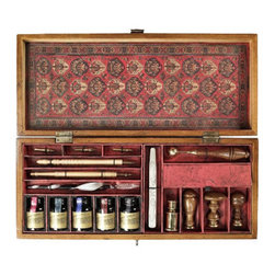 """Trianon Letters - The trianon letters measures 14.5 x 6.2 x 2.5"""". Compose a meaningful letter that will delight... Witty and pointed prose that will endure. Enjoy the power of the written word. Its contents? Too many parts to name. Inks, styluses, nibs, seal wax, sealing tools, brass and wood seals. A writer's dream. French finish box in rich  lustrous honey, locking with solid bronze hardware filled with writing instruments."""