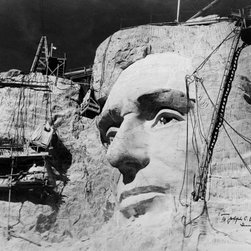 """Abraham Lincoln on Mount Rushmore Print - Sculpted face of Abraham Lincoln and construction equipment on Mount Rushmore, South Dakota. Photographed by Charles d'Emery of Manugian Studios, South Norwalk, Connecticut. Photographed in 1938. Autographed: """"To Joseph C. O'Mahoney, U.S.S., Sincerely yours, by Gutzon Borglum, 1938."""""""