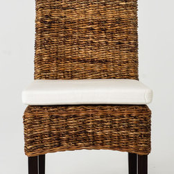 "Four Hands - Banana Leaf Side Chair with Cushion - Dining chairs like these make you think of summer all year long. This side chair has a mahogany frame with tall back that""s covered in a thickly woven banana leaf or abaca fiber to give it an impressive pattern and texture. The weaving continues well past the seat, which is covered with a fabric upholstered tie-on foam cushion for added comfort. Ideal for a sunroom or casual kitchen."