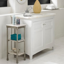 Home Styles The Orleans 3 Tier Tower - The Home Styles The Orleans 3 Tier Tower makes an excellent side-storage to your bathroom vanity or linen cabinet. This charming little piece incorporates design elements reminiscent of 18th century French/Creole cottages. A sturdy powder-coated steel frame supports the piece, featuring three marble laminate shelves that keeps soaps, towels, and more. Fitted feet and capped legs add extra stability to the design.About Home StylesHome Styles is a manufacturer and distributor of RTA (ready to assemble) furniture perfectly suited to today's lifestyles. Blending attractive design with modern functionality, their furniture collections span many styles from timeless traditional to cutting-edge contemporary. The great difference between Home Styles and many other RTA furniture manufacturers is that Home Styles pieces feature hardwood construction and quality hardware that stand up to years of use. When shopping for convenient, durable items for the home, look to Home Styles. You'll appreciate the value.