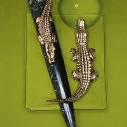 L'Objet Crocodile Desk Accessories - These golden crocodile accessories are a splurge, but they will bling out your desk like nothing else can. They really are a royal desk treatment.