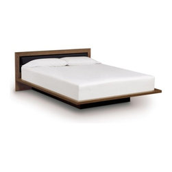 "Copeland Furniture - Copeland Furniture | Moduluxe 29-Inch Platform Bed with Microsuede Headboard - Made in Vermont by Copeland Furniture.The Moduluxe 29-Inch Platform Bed with Microsuede Headboard is a modern platform bed with a softly upholstered inset headboard. The cozy yet crisply styled silhouette features solid maple, cherry or American black walnut hardwood construction with an inset headboard in tufted microsuede, offered in several colors. A deeply set plinth base gives the bed its visually stunning floating motif. The Moduluxe Platform Bed with Microsuede Headboard is designed for use with a mattress only (recommended mattress height - 10"") and is available in Queen, King or Cal King sizes. Select bed size and wood color/finish in one of two satin surface finishes: standard Copeland Lacquer top coat or formaldehyde free Copeland Water Based top coat. Then select Microsuede color. Copeland Furniture's Moduluxe Series offers sectional furniture for the bedroom. This highly configurable bedroom and storage system adapts to most spaces and needs. The Moduluxe Platform Bed with Microsuede Headboard is a stylish standalone piece or may be configured with the Moduluxe range of dresser and desk elements for a custom modular bedroom. The Moduluxe Box Nightstand and Shelf Nightstand (both sold separately) can be added to this bed frame to create integrated side table storage."