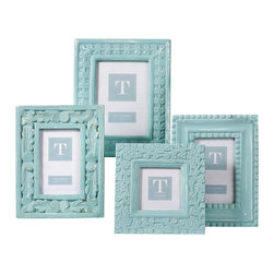 Distressed Aqua Photo Frames - Set of 4 - A different timeless high-relief design is carved into each of the Set of Four Distressed Aqua Photo Frames, but all share the elements of proportion and theme, pulling together a home decor look that's both unified and well-travelled in a delicate shade perfect for bedrooms and dining rooms. Fill with sepia snaps or candid wedding photos for a charming decorative detail.