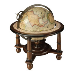 "Navigator's Terrestrial Globe - The navigator's terrestrial table globe measures 11.75 x 10.5"". It features a printed horizontal ring and functioning dry compass with bronze meridian circle. Decorative and well-executed globe from the age of exploration. Stand is detailed turned wood, walnut finish with ball feet. Exact reproduction of 16th C. Mercator globe, hand applied paper gores."