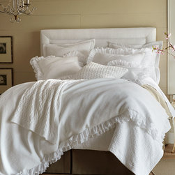 Penelope Duvet Cover - King - A country romance in Egyptian cotton, the Penelope Duvet Cover brings ephemeral heirloom aesthetics to the traditional home with a tactile cotton piquet accented by double layers of ruffled flange. The result is a delicate look mixed with transitional practicality, both durable and timelessly elegant. Pure white cotton creates a fresh, relaxed look.