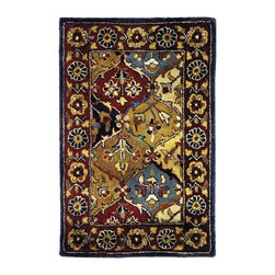 Safavieh - Hand-Tufted Wool Rug in Navy and Multi (2 ft. x 3 ft.) - Size: 2 ft. x 3 ft. Hand Tufted. Made of Wool. Made in India. Interlocking ornament-shaped patterns at the center of this rug are opulent adornments. The border offers equally intense visuals that will add rich colors in traditional spaces. It's bursting with details that will complement solids and smaller pattern choices in a room.