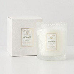 """Anthropologie - Voluspa Boxed Candle - 55 hour burn time. Coconut wax blend. 3.75""""H, 3"""" diameter. 6.2 oz. USA. Santiago Huckleberry: sweet and spicy, with hints of vanilla pod and sugarcane . Baltic Amber: forest scents of sandalwood and cedar. Goji Berry: cold-pressed tarocco orange blended with sun-dried goji berries. French Cade: a refreshing blend of French cade wood, lavender, verbena and moss. Mokara: a floral mix of Mokara orchid, white lily and spring moss. Crane Flower: ripened grapefruit combines with geranium, lavender and nectar inspired by the Birds of Paradise flower"""