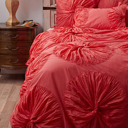 Lanna Duvet Cover - The twisted pinwheels on this coral duvet drive me mad.